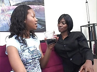 Two horny black dykes use strapon